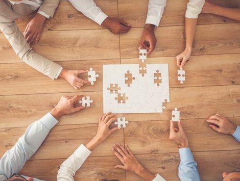 team-placing-puzzle-pieces